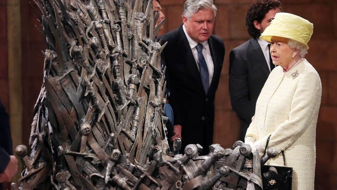 Queen Elizabeth II views the Iron Throne on the set of Game of Thrones in Belfast's Titanic Quarter on June 24, 2014 in Belfast, Northern Ireland. The Royal party are visiting Northern Ireland for three days.