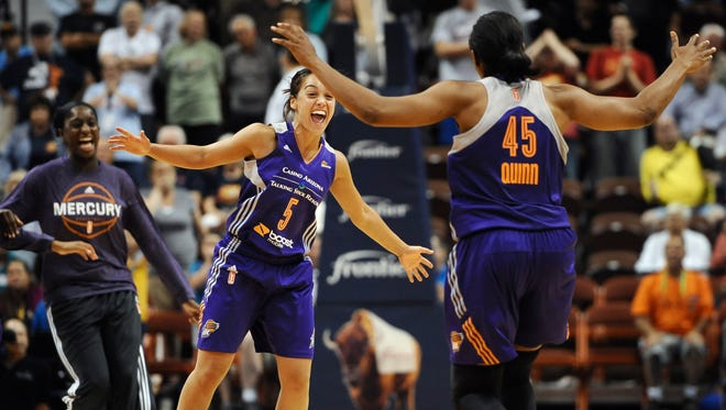 The Mercury's Leilani Mitchell reacts with teammate Noelle Quinn, right, after Mitchell scored the game-winning basket during the second half of a WNBA basketball game against the Connecticut Sun, Thursday, Aug. 27, 2015, in Uncasville, Conn.  Phoenix won 81-80.