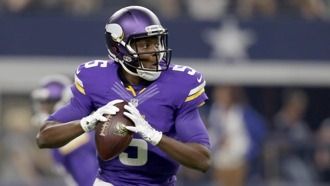 Minnesota Vikings quarterback Teddy Bridgewater (5) rolls out to pass against the Dallas Cowboys during the first half of a preseason NFL game Aug. 29 in Arlington, Texas.