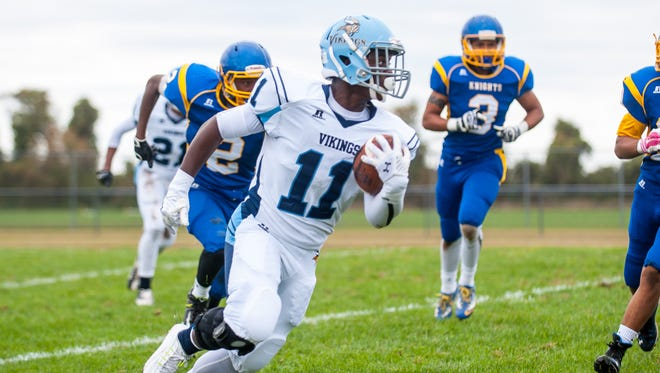 Cape Henlopen running back Rasheed Woods (11) finds the open field against Sussex Central on Saturday afternoon at Sussex Central.