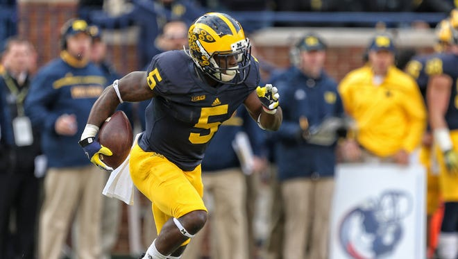 Michigan safety Jabrill Peppers runs back a kickoff against the Michigan State Spartans.