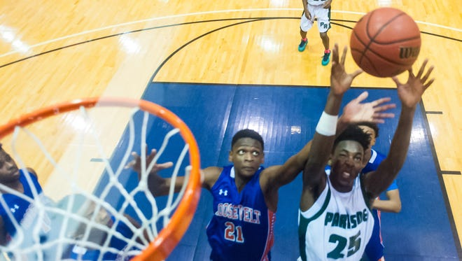 Parkside center Tyrese Purnell (25) fights for a rebound against Roosevelt during the Governor's Challenge on Saturday at the Wicomico Youth and Civic Center in Salisbury.