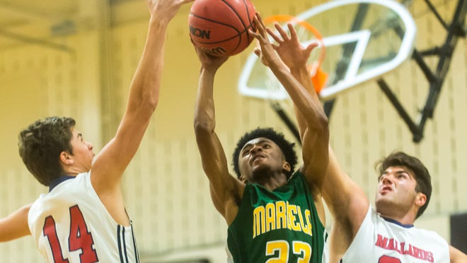 Mardela guard Tyler McCoy (23) takes a shot against Worcester Prep on Monday, Dec. 28, at Wicomico High School as part of the Governor's Challenge.