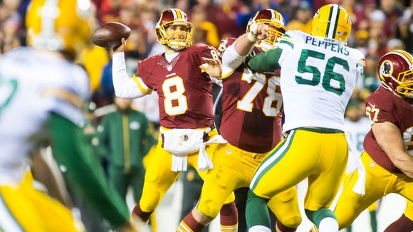 Washington quarterback Kirk Cousins (8) drops back for a touchdown pass against Green Bay in the NFL Wild Card Playoff on Sunday, January 10th at FedEx Field in Landover, MD.