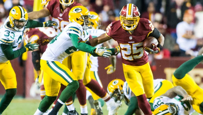 Washington running back Chris Thompson (24) shakes off a Green Bay tackle in the NFL Wild Card Playoff on Sunday, January 10th at FedEx Field in Landover, MD.