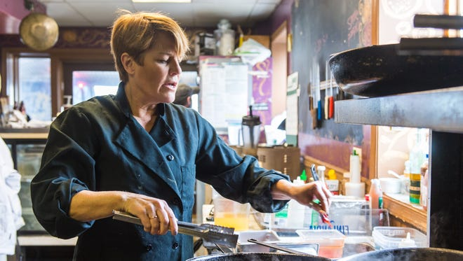 Gretchen Hanson puts peppers into tomatos and garlic for hearts of palm tacos at Hobos in Rehoboth Beach on Friday, January 15.