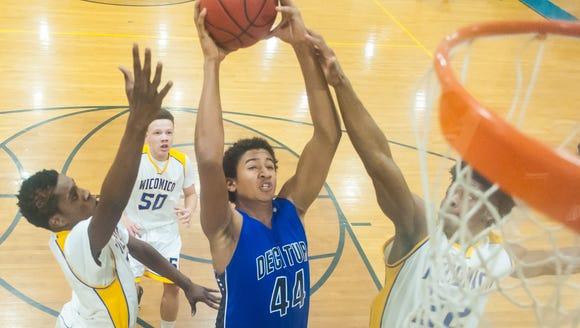 Stephen Decatur junior center Keve Aluma elevates for
