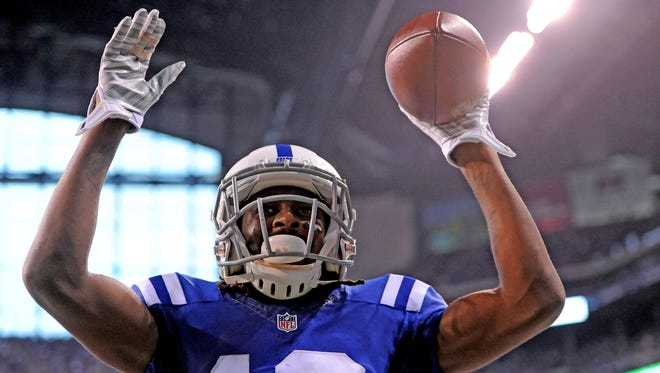 Indianapolis Colts receiver TY Hilton (13) celebrates a first half score against the Washington Redskins  at Lucas Oil Stadium.