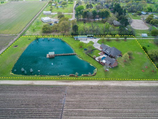 The property is surrounded by open spaces and farm land.