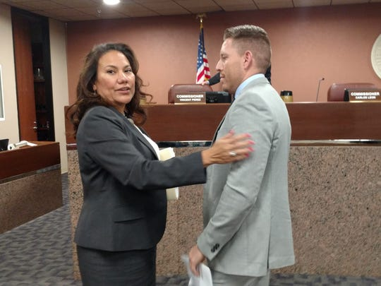 Veronica Escobar talks to her replacement, Ruben Vogt, after county commissioners chose him 4-1 on Monday to replace her as county judge.