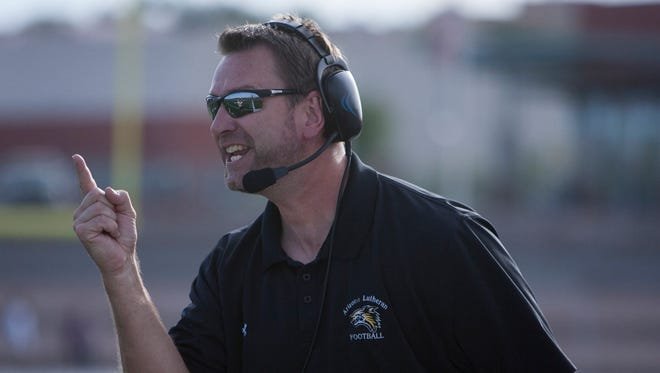 Arizona Lutheran coach Scott Indahl instructs his players during the semifinal game against the Tempe Prep Knights on Nov. 22, 2014.