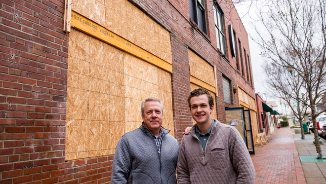 Tom and Wes Cunningham stand in front of what will be Strawberry Alley Ale Works, a new restaurant and brewery set to open April 2.