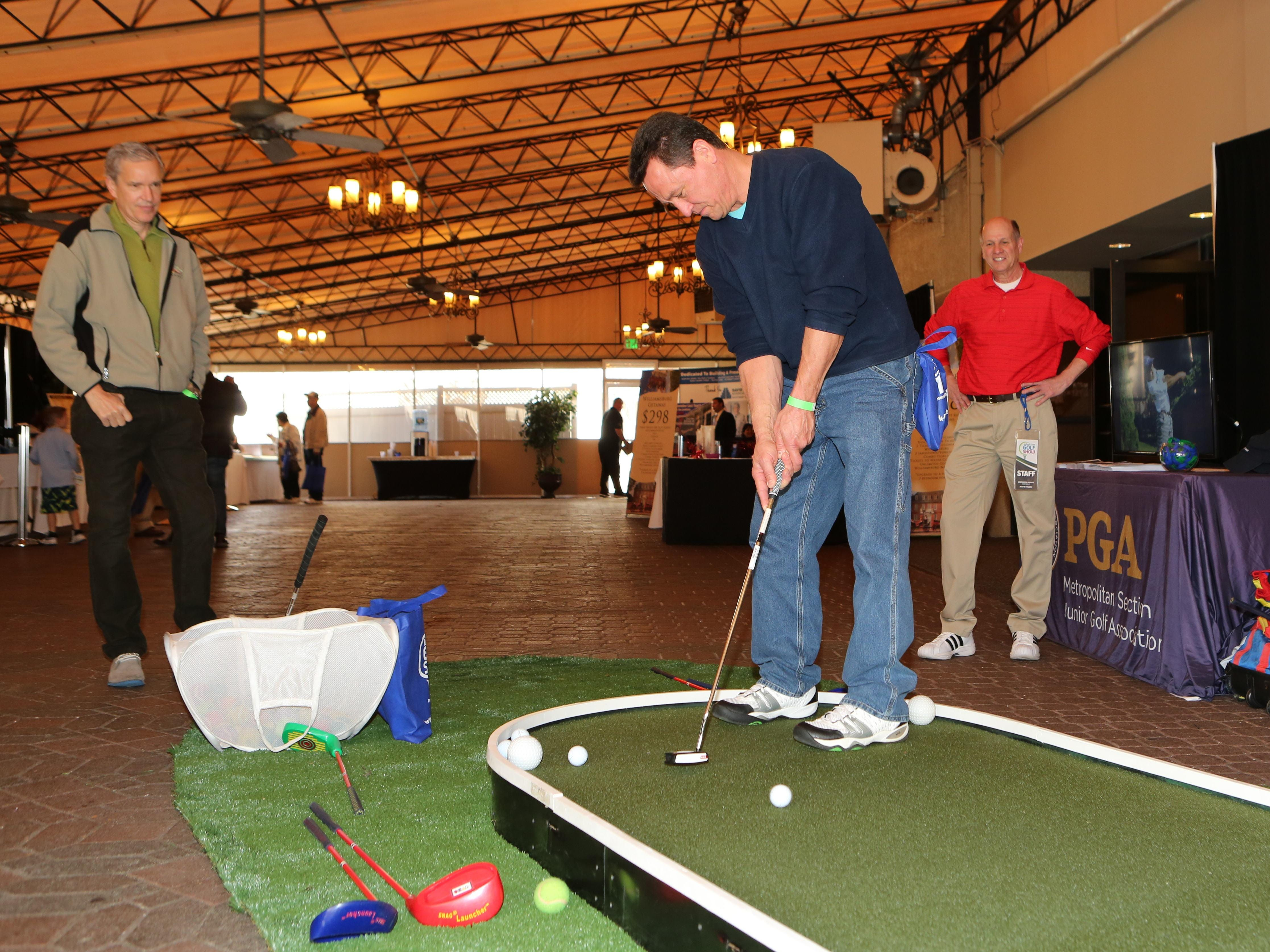 Joe Moravsky from Sherman, Connecticut, gives putting a try at the lohud.com Golf Show at the Westchester Marriott in Tarrytown Saturday. The show continues Sunday.