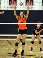 Emily Perez, 4, of El Paso High awaits the serve from