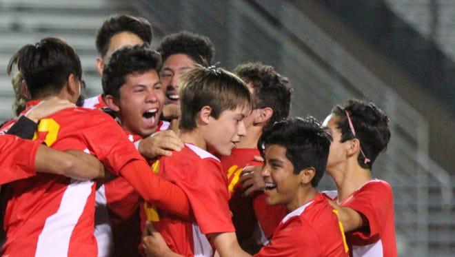 Palm Desert's soccer team celebrates a DVL win against La Quinta High School in La Quinta on Thursday night, February 11, 2016. Palm Desert won.