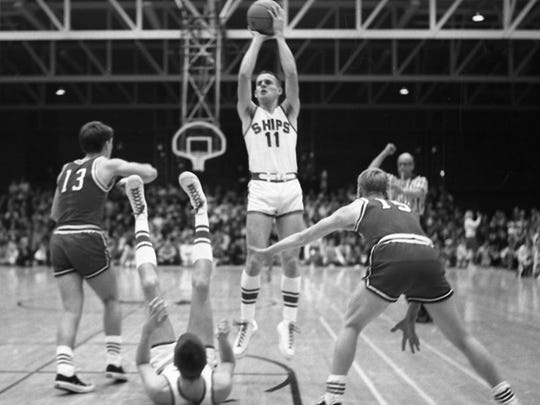 Bill Stepnafski takes a shot in the lane during Manitowoc's sectional final victory over Neenah at JFK Fieldhouse. The Ships would go on to win the 1968 state championship.