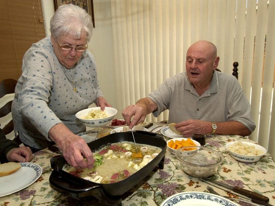 Sparks Mayor Geno Martini, right, and his mother Erma prepare Bagna Calda, a type of Italian fondue, at his home in Sparks. At that time, Martini was serving as council member for Ward 3.