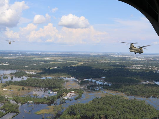 Three Chinook helicopters from the 2nd Battalion, 501st Aviation Regiment delivered 13,400 packaged meals from the Federal Emergency Management Agency to those in the eastern Houston region who were lacking necessities following Hurricane Harvey on Sept. 5.