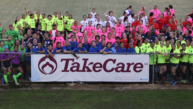 Participants in a previous edition of the TakeCare Achieve Your Goals Women's Soccer Event pose for a group photo at the Guam Football Association National Training Center before breaking up into groups for various soccer activity stations facilitated by GFA coaches. The event takes on a new, six-week format and will also include a coaching certificate course. The event officially opens Sept. 7, with sessions every Thursday to Oct. 12. Interested participants may register online at http://www.takecareasia.com/achieveyourgoals
