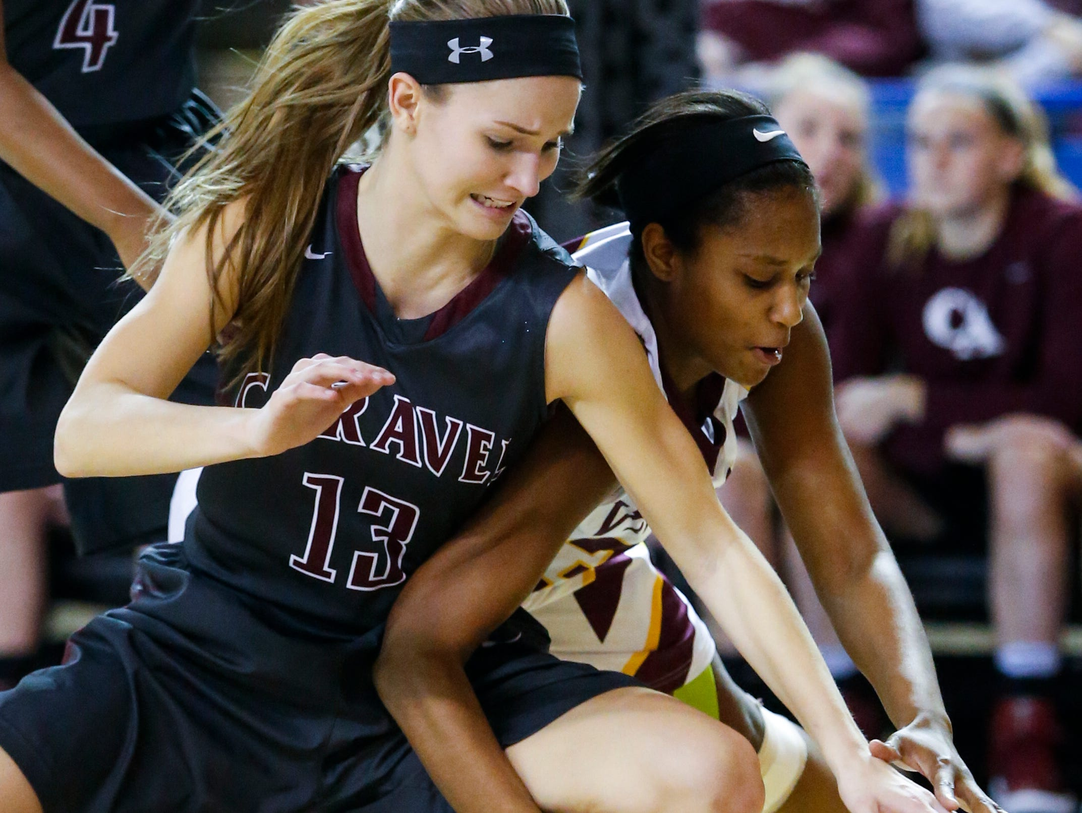 Caravel's Grace Lange (left) clashes with St. Elizabeth's Alanna Speaks for a loose ball in the first half of a DIAA state tournament semifinal Wednesday.