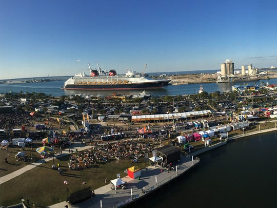 A cruise ship sails by as the Space Coast Seafood and Music Festival near at Port Canaveral. This year's festival is March 7-10.
