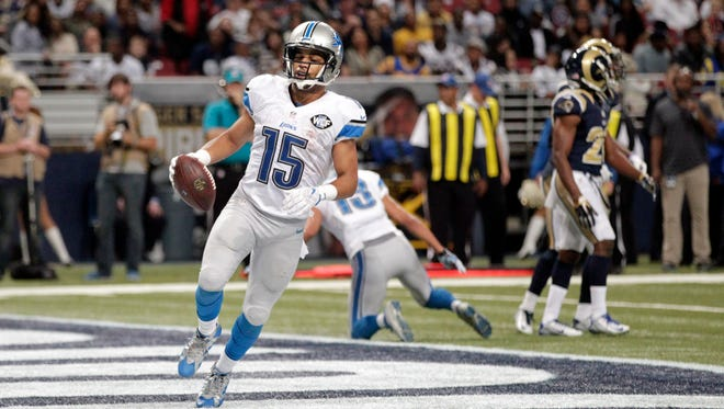 Detroit Lions wide receiver Golden Tate runs into the end zone after catching a two-yard pass for a touchdown against the St. Louis Rams on Dec. 13, 2015, in St. Louis.