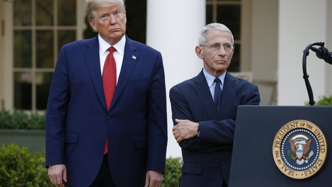 President Donald Trump and Dr. Anthony Fauci, right, director of the National Institute of Allergy and Infectious Diseases, attend a coronavirus task force briefing in the Rose Garden of the White House, Sunday, March 29, 2020, in Washington. (AP Photo/Patrick Semansky)