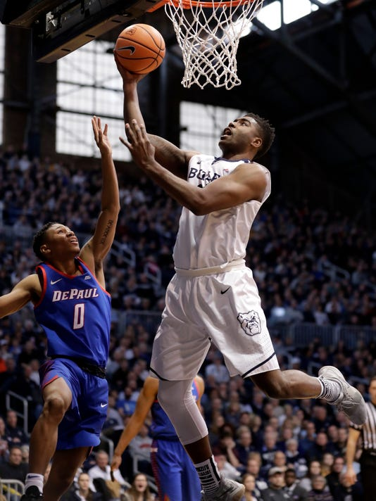 FILE - In this Feb. 3, 2018, file photo, Butler forward Kelan Martin (30) shoots over DePaul guard Justin Roberts (0) in the first half of an NCAA college basketball game in Indianapolis. Kelan Martin always has been a special scorer. This season, he learned to thrive in a new role — team leader. (AP Photo/Michael Conroy, File)