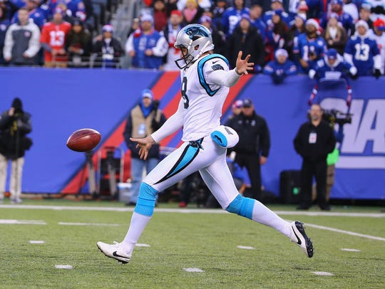 Brad Nortman punts during the Panthers-Giants game