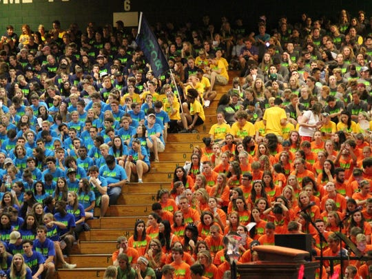 A sea of new students in different colored shirts packed the Patrick Gymnasium Complex during Sunday's new student convocation at the University of Vermont.
