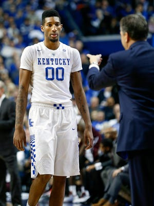 Kentucky's Marcus Lee leaves the court after fouling out.   Jan. 12, 2016