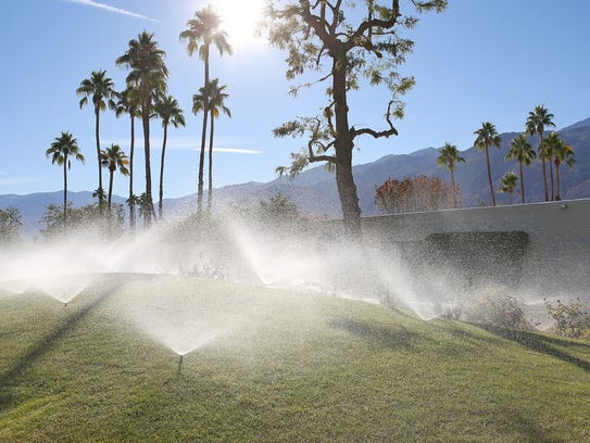 Sprinklers douse a grassy area in Palm Springs.