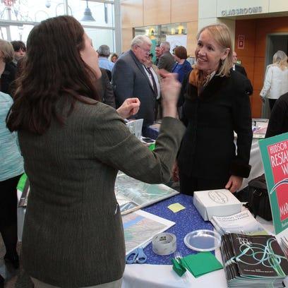 Putnam Tourism Director Libby Pataki, center, talks