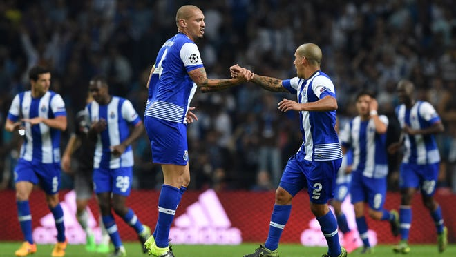 Porto defender Maicon, left, celebrates a goal with Maxi Pereira during their UEFA Champions League match against Chelsea.