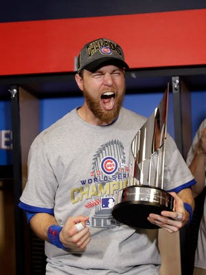 Cubs outfielder Ben Zobrist celebrates with the MVP trophy.