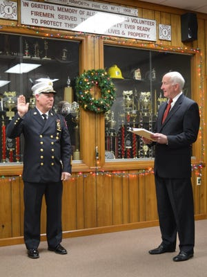 Fire Chief Michael Green sworn in at the reorganization meeting in January of 2016. He is sworn in here by Mayor John Smart. Green was involved in an auto accident that totaled his vehicle back in February. The council is currently setting aside funds for a new vehicle although the capital budget has not yet been introduced.