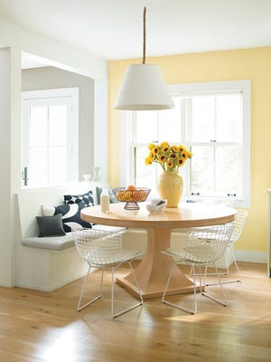 It's hard to resist this kitchen accent in Benjamin Moore's Hawthorne Yellow. It works well with all of the white trim, ceilings and the white banquette and chairs. And the lemons and sunflowers.