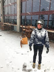In this image provided by Northstar California, Jessie Hall, an employee at the Northstar California Resort looks out at the first snow of the season Thursday, Sept. 21, 2017, in Truckee, Calif.