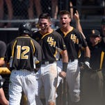 Southern Miss baseball players celebrate after a play during the Conference USA tournament championship game on Sunday at Pete Taylor Park.