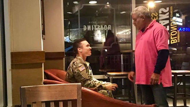 Local blogger and writer Kaitlyn McConnell snapped this photo of two veterans having a heartwarming chat at a south Springfield Starbucks Coffee. Afterward, 4,000 people reacted to it on Facebook.