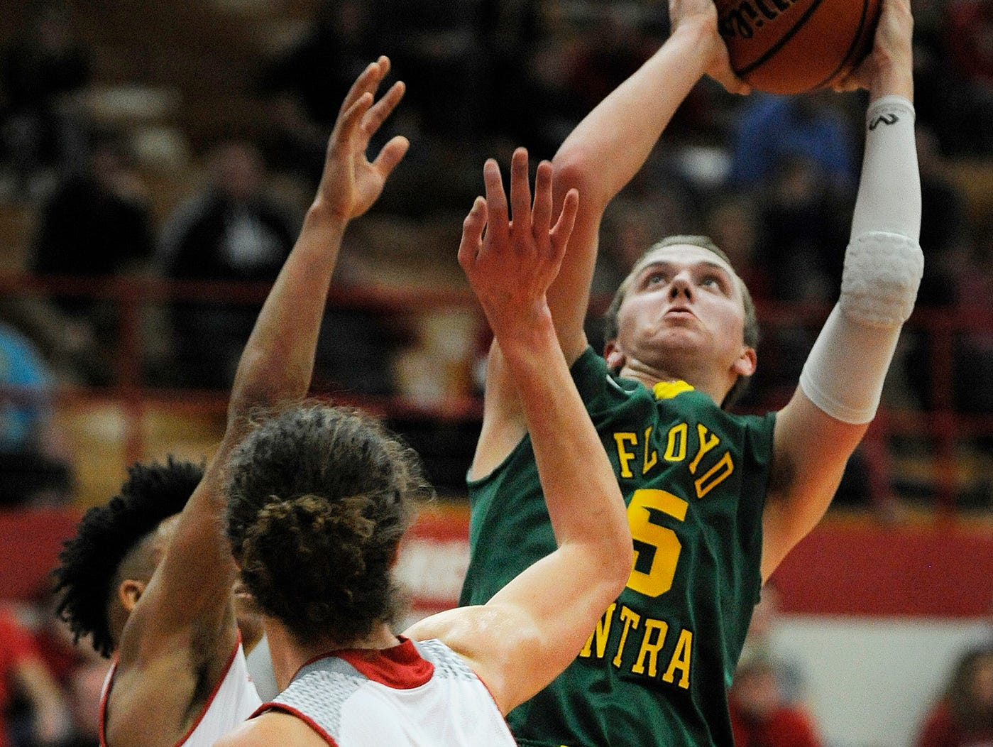 Floyd Central's Tyler Kimm (5) brings down a rebound against Jeffersonville on Friday at Jeffersonville High School.