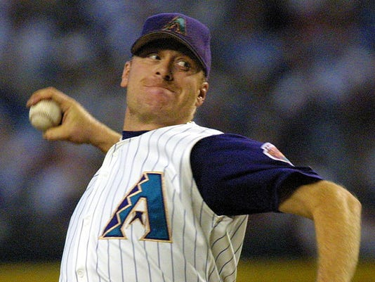 Arizona Diamondbacks' Curt Schilling delivers a pi