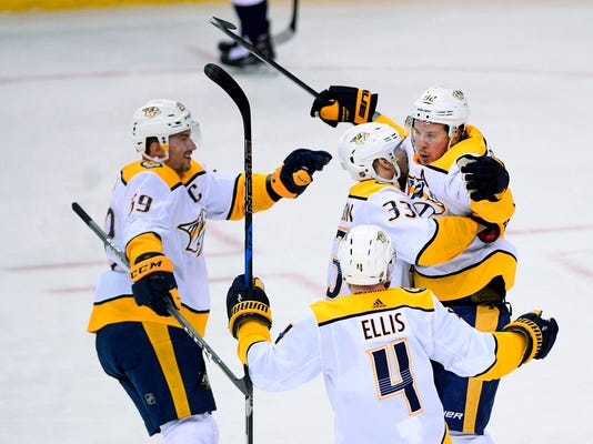 Nashville Predators center Ryan Johansen (92) celebrates his goal with left wing Viktor Arvidsson (33), of Sweden, defenseman Ryan Ellis (4) and defenseman Roman Josi (59), of Switzerland, during the third period of an NHL hockey game against the Washington Capitals, Thursday, April 5, 2018, in Washington. The Predators won 4-3. (AP Photo/Nick Wass)
