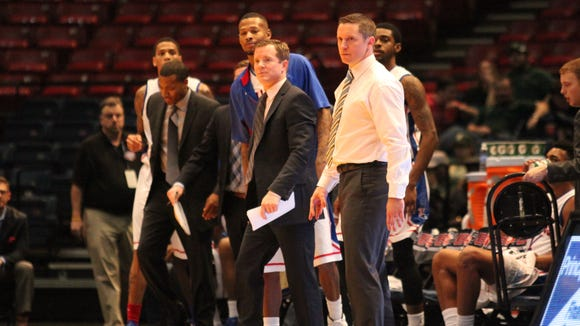 Mike White, far right, is taking two assistant coaches