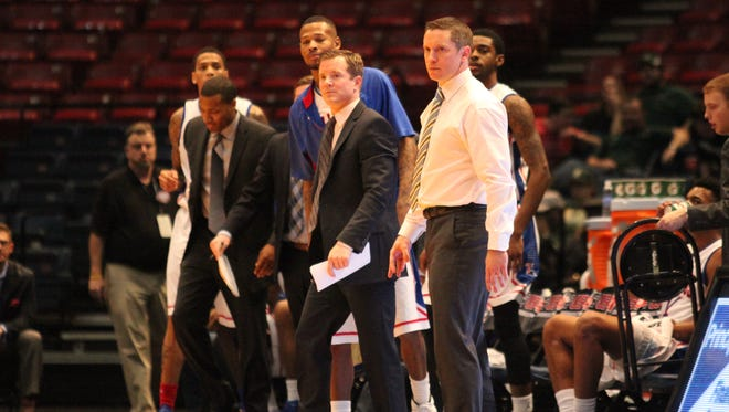 Mike White, far right, is taking two assistant coaches with him to Florida, including Darris Nichols, far left.