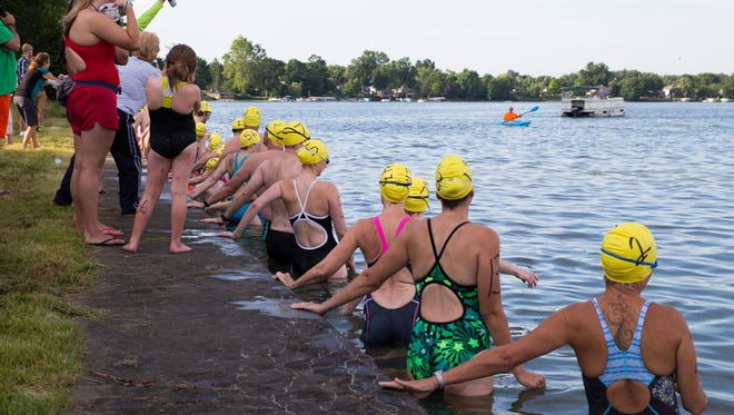 Swimmers line up at Willard Beach to start the 2015 Goguac Lake Swim Saturday morning.