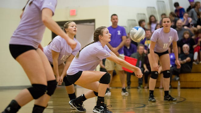 Marine City's Halie Johnson digs the ball during a volleyball game Wednesday, Oct. 5, 2016 at Cardinal Mooney High School.