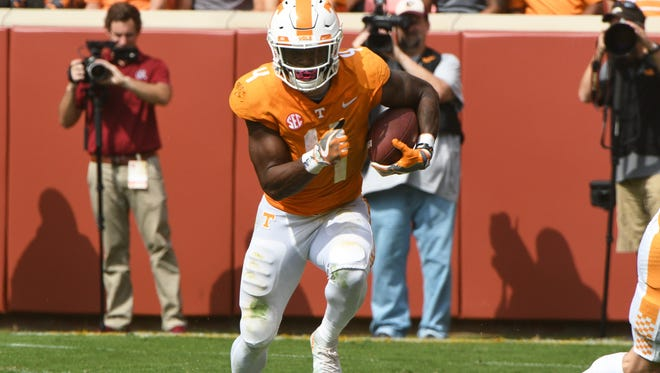 Tennessee running back John Kelly (4) runs with the ball during the first half of a Tennessee vs. South Carolina game at Neyland Stadium in Knoxville, Tenn. Saturday, Oct. 14, 2017.
