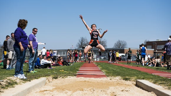 York Suburban's Mary Gurnavage competes in the girls' long jump Saturday at Northern York County High School in the Arctic Blast Track and Field Invitational.