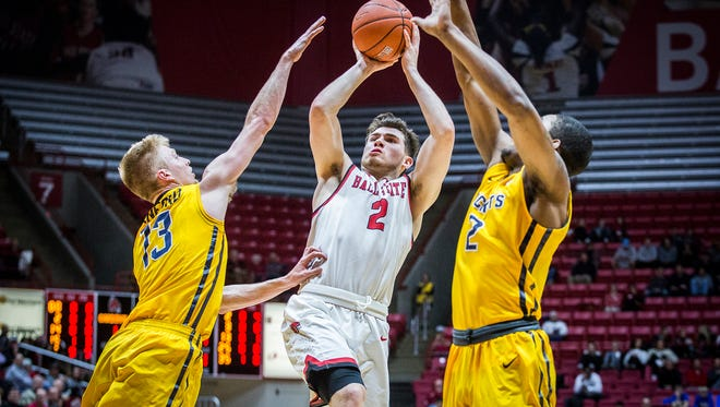 Ball State's Tayler Persons shoots past Toledo's defense during their game at Worthen Arena Tuesday, Jan. 31, 2017.